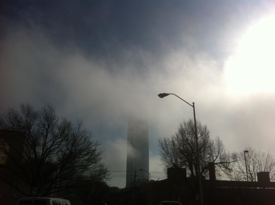 Photo - Fog shrouds the new Devon building being erected downtown Oklahoma City. Photo by Robert Medley