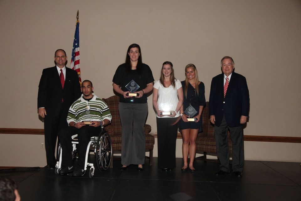 Oklahoma athletic director Joe Castiglione, far left, and president David Boren, far right, stand with Athletic Council Achievement Award winners, from left, Corey Wilson, Jelena Cerina, Natasha Kelley and Peta Maree Lancaster at the Max Weitzenhoffer Scholar Athlete Breakfast on Tuesday in Norman.  PHOTO PROVIDED