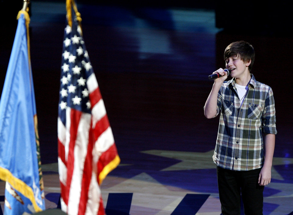 Photo - Greyson Chance sings the National Anthem before game 4 of the Western Conference Finals in the NBA basketball playoffs between the Dallas Mavericks and the Oklahoma City Thunder at the Oklahoma City Arena in downtown Oklahoma City, Monday, May 23, 2011. Photo by Bryan Terry, The Oklahoman