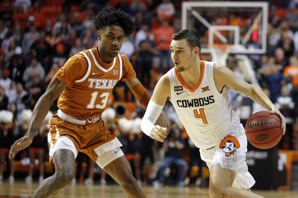 Photo - Oklahoma State's Thomas Dziagwa (4) goes past Texas' Jase Febres (13) during an NCAA basketball game between the Oklahoma State University Cowboys (OSU) and the Texas Longhorns at Gallagher-Iba Arena in Stillwater, Okla., Wednesday, Jan. 15, 2020. [Bryan Terry/The Oklahoman]