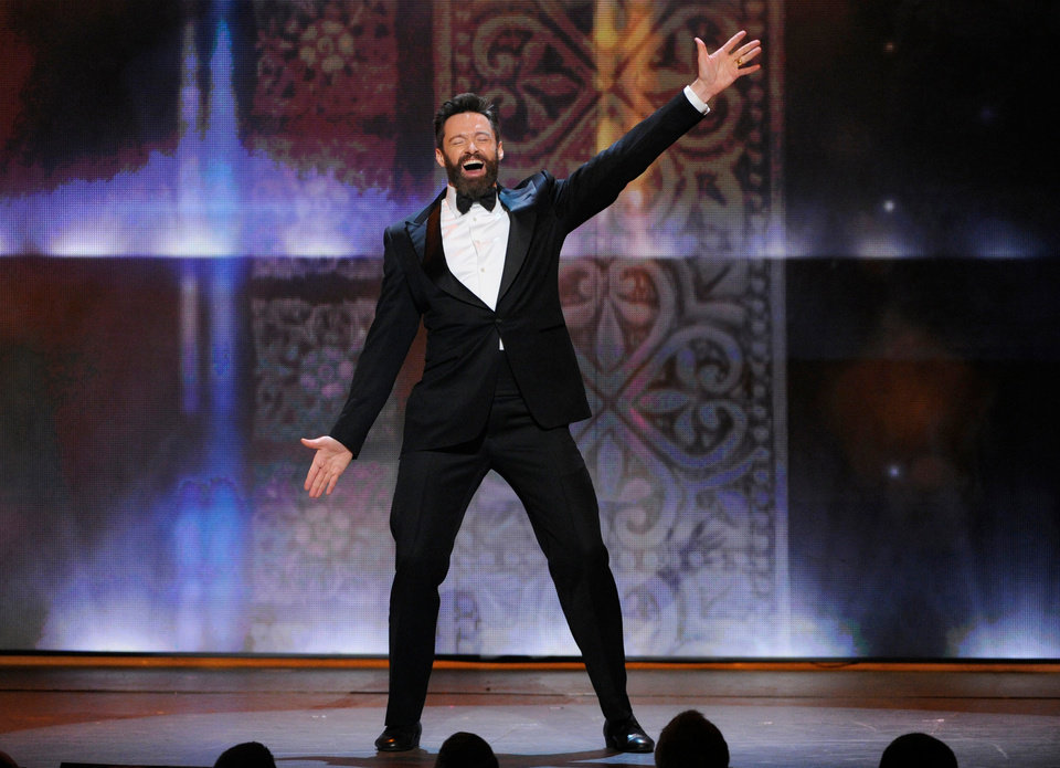Photo - Host Hugh Jackman performs on stage at the 68th annual Tony Awards at Radio City Music Hall on Sunday, June 8, 2014, in New York. (Photo by Evan Agostini/Invision/AP)