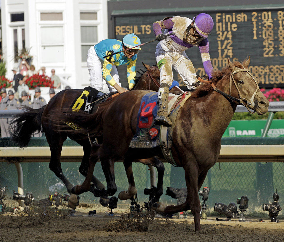 Jockey Mario Gutierrez rides I'll Have Another to victory past Bodemeister ridden by Mike Smith (6) to victory in the 138th Kentucky Derby horse race at Churchill Downs Saturday, May 5, 2012, in Louisville, Ky. (AP Photo/Mark Humphrey)  ORG XMIT: DBY179