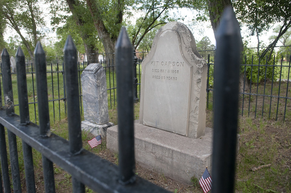 Photo - This photo taken on Wednesday, June 11, 2014, shows Kit Carson's grave in Kit Carson Memorial Cemetery at Kit Carson Park in Taos, N.M. The Taos Town Council passed a resolution Tuesday to rename the downtown park Red Willow over concerns by critics that the famed scout was cruel to American Indians. (AP Photo/The Albuquerque Journal, Eddie Moore) MANDATORY CREDIT