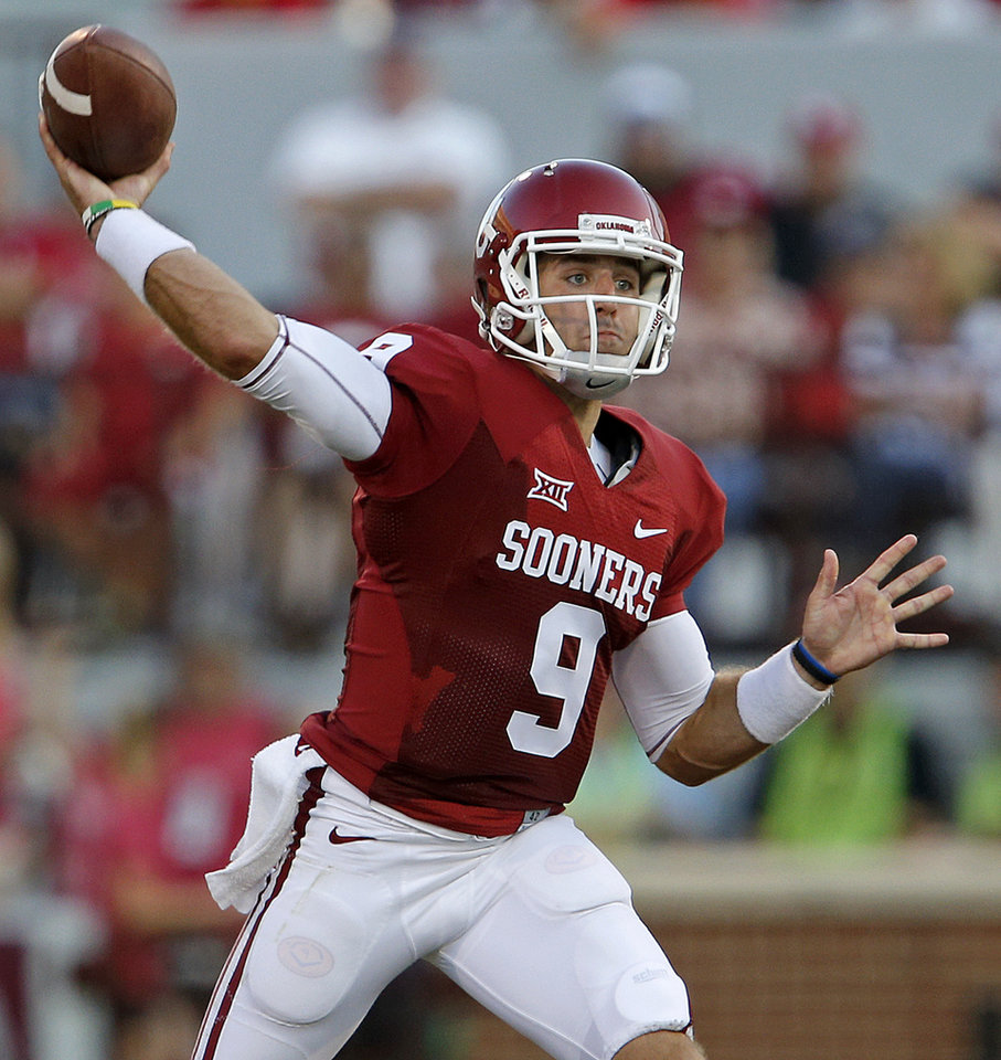 Photo - Oklahoma's Trevor Knight (9) passes during a college football game between the University of Oklahoma Sooners (OU) and the Louisiana Tech Bulldogs at Gaylord Family-Oklahoma Memorial Stadium in Norman, Okla., on Saturday, Aug. 30, 2014. Photo by Bryan Terry, The Oklahoman
