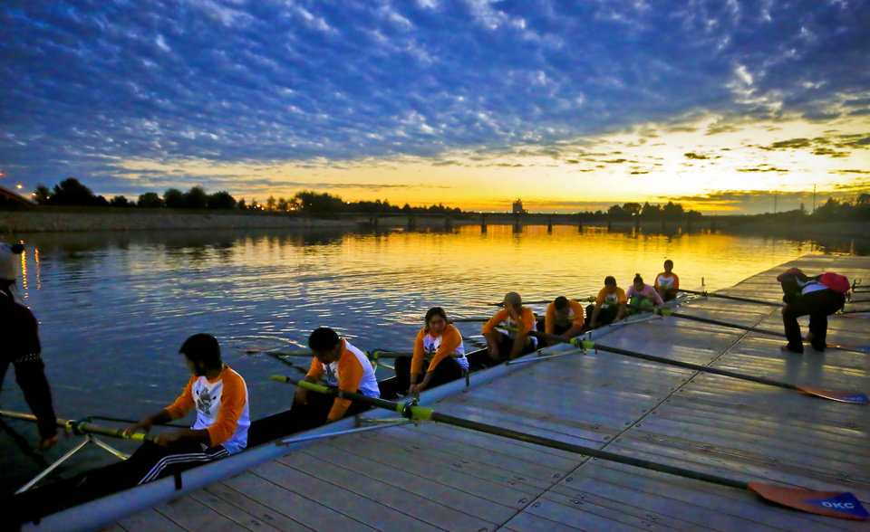 Photo - Members of the Santa Fe South rowing team prepare for their heat race during the Sandridge Youth High School Rowing League Championships on the Oklahoma River on Sunday, Nov. 8, 2015, in Oklahoma City, Okla.Photo by Chris Landsberger, The Oklahoman