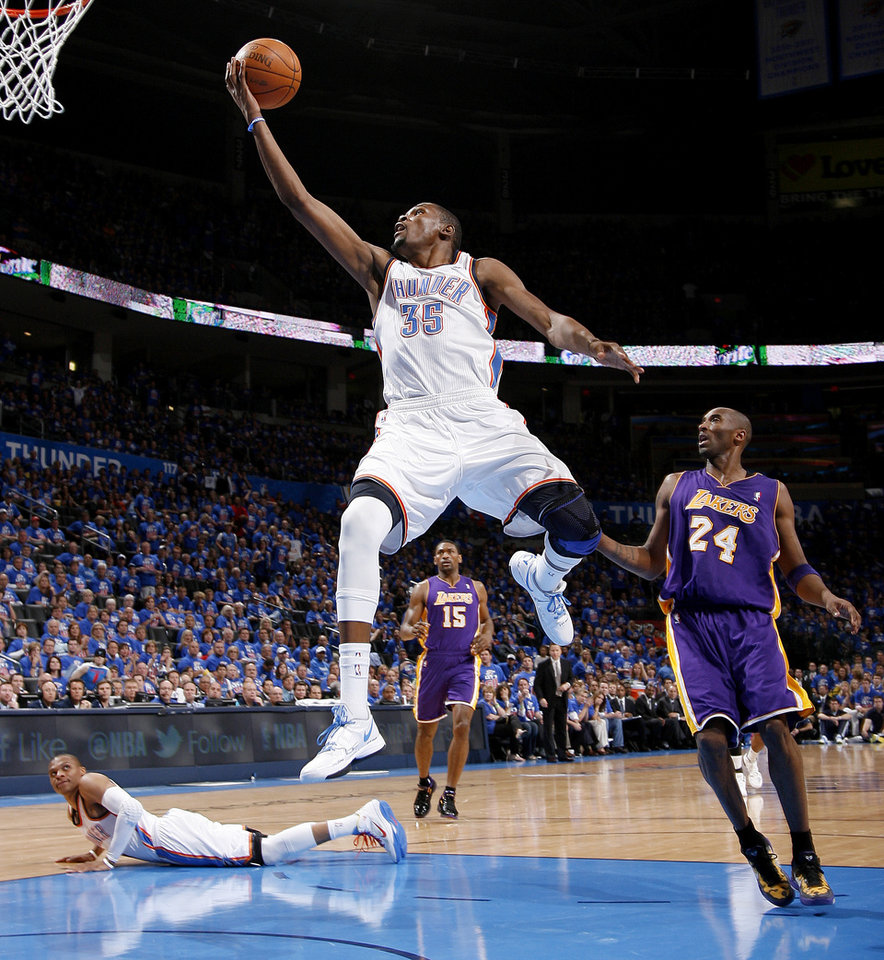 Photo - Oklahoma City's Kevin Durant (35) goes past Los Angeles' Kobe Bryant (24) as Russell Westbrook (0) watches during Game 5 in the second round of the NBA playoffs between the Oklahoma City Thunder and the L.A. Lakers at Chesapeake Energy Arena in Oklahoma City, Monday, May 21, 2012. Oklahoma City won 106-90.  Photo by Bryan Terry, The Oklahoman