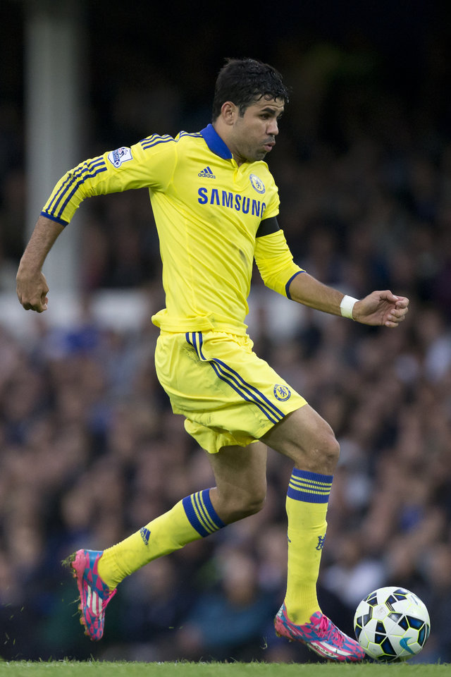 Photo - Chelsea's Diego Costa takes the ball downfield during his team's English Premier League soccer match against Everton at Goodison Park Stadium, Liverpool, England, Saturday Aug. 30, 2014. (AP Photo/Jon Super)