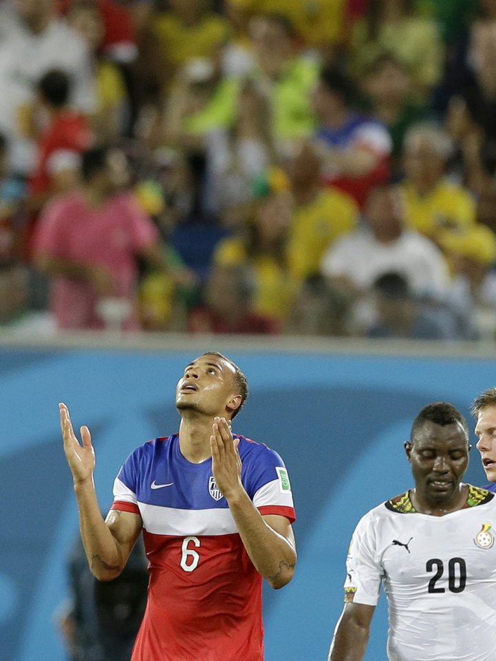 Photo - United States' John Brooks, left, celebrates after scoring his side's second goal during the group G World Cup soccer match between Ghana and the United States at the Arena das Dunas in Natal, Brazil, Monday, June 16, 2014.   (AP Photo/Ricardo Mazalan)