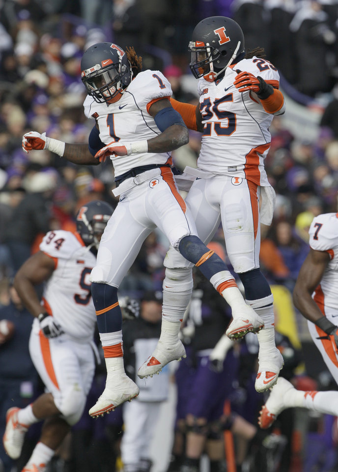 Photo -   Illinois defensive back Terry Hawthorne (1) and Ashante Williams (25) celebrate after Hawthorne intercepted a pass during the first half of an NCAA college football game against Northwestern in Evanston, Ill., Saturday, Nov. 24, 2012. (AP Photo/Nam Y. Huh)
