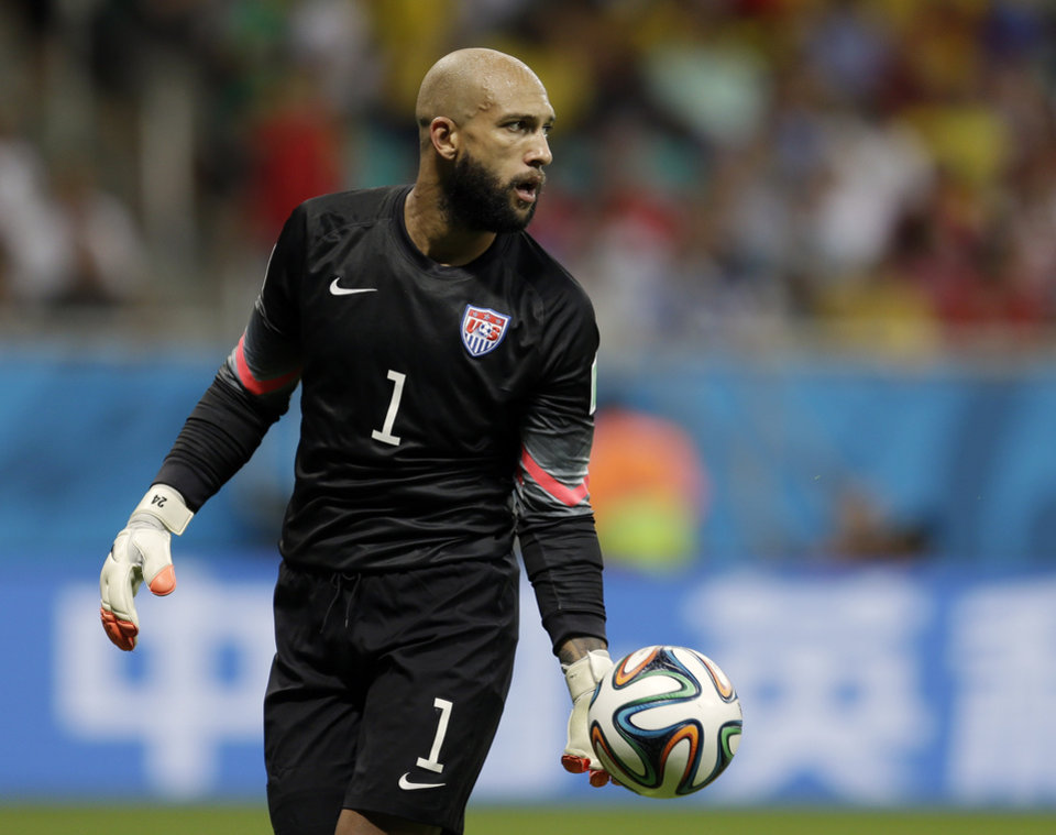 Photo - United States' goalkeeper Tim Howard gets ready to kick the ball during the World Cup round of 16 soccer match between Belgium and the USA at the Arena Fonte Nova in Salvador, Brazil, Tuesday, July 1, 2014. (AP Photo/Natacha Pisarenko)