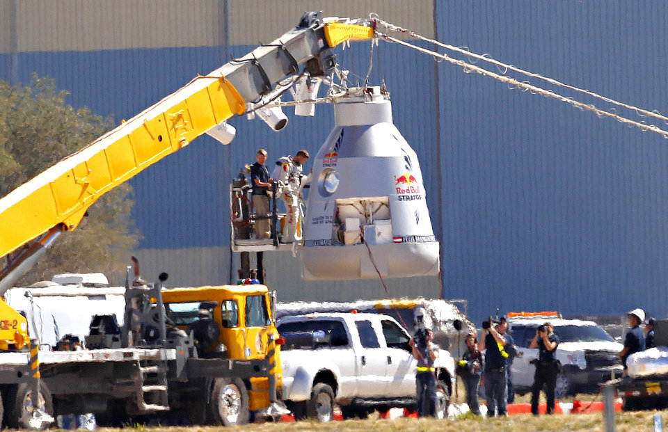Felix Baumgartner disembarks from the balloon capsule after his mission was aborted in Roswell, N.M. on Tuesday, Oct. 9, 2012. Baumgartner was attempting to break the speed of sound with his own body by jumping from the capsule lifted 23 miles high by a 30 million cubic foot helium balloon. (AP Photo/Matt York)