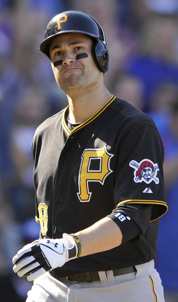 Photo -   Pittsburgh Pirates' Neil Walker reacts to striking out in the sixth inning during a baseball game against the Chicago Cubs in Chicago, Friday, Sept. 14, 2012. Chicago won 7-4. (AP Photo/Paul Beaty)