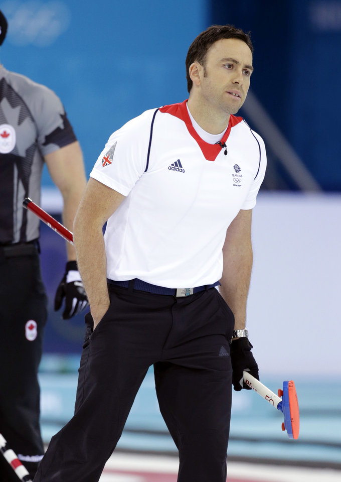 Photo - Britain skip David Murdoch reacts after delivering the rock during the men's curling gold medal game against Canada at the 2014 Winter Olympics, Friday, Feb. 21, 2014, in Sochi, Russia. (AP Photo/Robert F. Bukaty)
