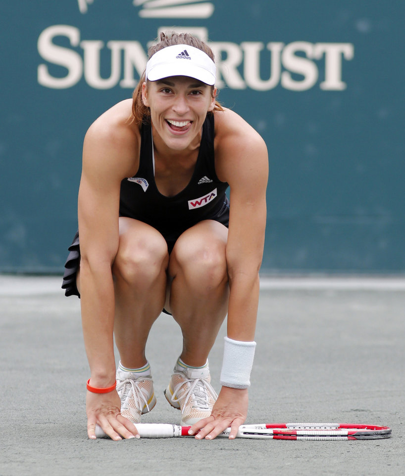 Photo - Andrea Petkovic, of Germany, reacts after defeating Jana Cepelova, of Slovakia, in two sets during the Family Circle Cup tennis tournament final in Charleston, S.C., Sunday, April 6, 2014. Petkovic won 7-5, 6-2 to win the championship. (AP Photo/Mic Smith)