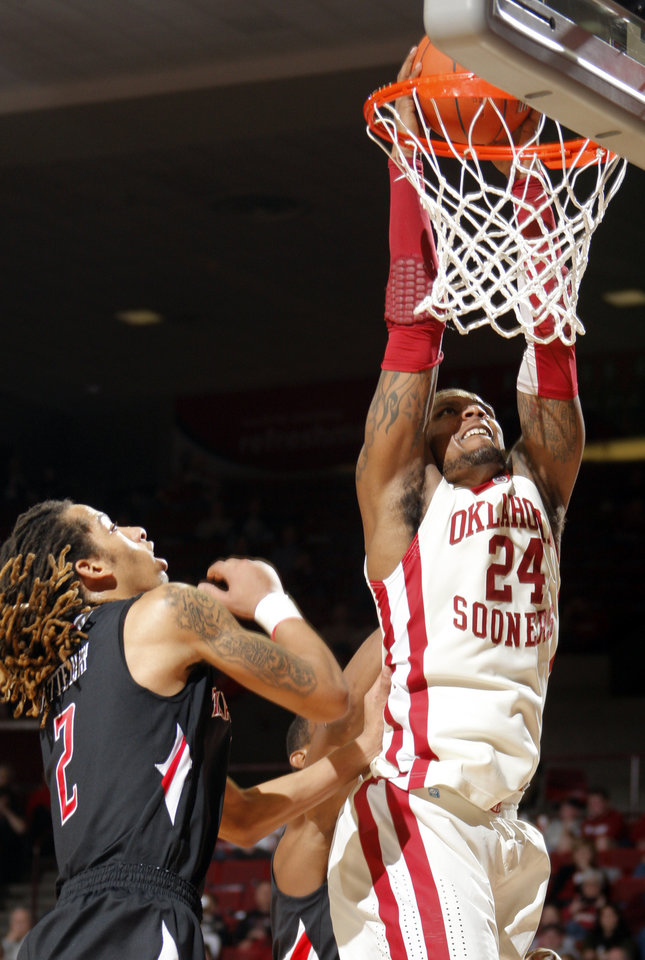 Oklahoma\'s Romero Osby (24) dunks over Texas Tech\'s Terran Petteway (2) during the men\'s college basketball game between the University of Oklahoma and Texas Tech University of at the Lloyd Nobel Center in Norman, Okla., Tuesday, Jan. 17, 2012. Photo by Sarah Phipps, The Oklahoman