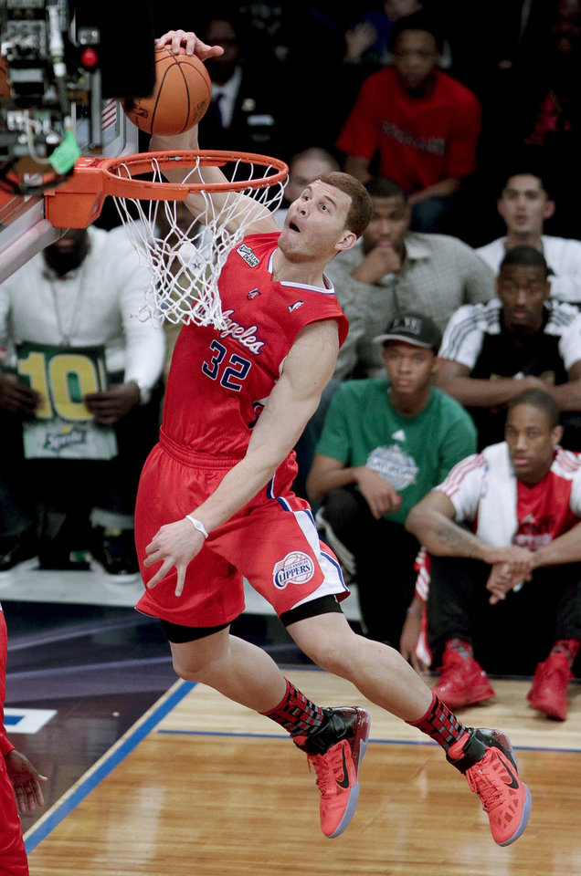 Photo - Los Angeles Clippers' Blake Griffin dunks during the Slam Dunk Contest at the NBA basketball All-Star Saturday Night, Saturday, Feb. 19, 2011, in Los Angeles.  (AP Photo/Jae C. Hong)