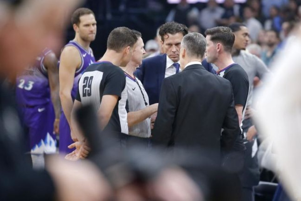 Photo -  Utah Jazz coach Quin Snyder meets with Oklahoma City coach Billy Donovan and officials before an NBA basketball game between the Oklahoma City Thunder and the Utah Jazz was postponed at Chesapeake Energy Arena in Oklahoma City, Wednesday, March 11, 2020. [Bryan Terry/The Oklahoman]