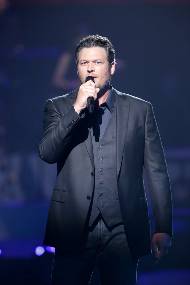 This image released by NBC Universal shows country singer Blake Shelton during the Healing in the Heartland: Relief Benefit Concert at the Chesapeake Energy Arena in Oklahoma City, Okla., Wednesday, May 29,2013. Funds raised by the benefit will go to the United Way of Central Oklahoma, for recovery efforts for those affected by the May 20 tornado. (AP Photo/NBC, Brett Deering) ORG XMIT: NYET101
