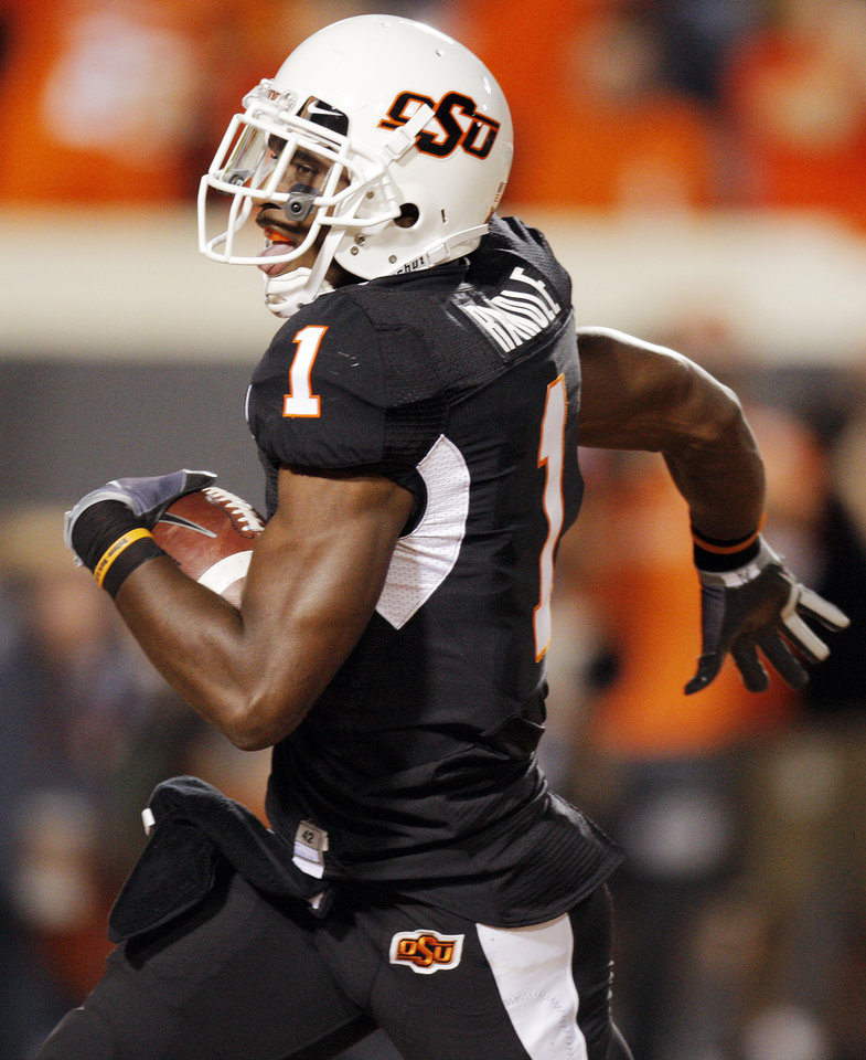 Photo - OSU's Joseph Randle (1) scores a touchdown on a 39-yard reception in the second quarter during the college football game between Texas A&M University and Oklahoma State University (OSU) at Boone Pickens Stadium in Stillwater, Okla., Thursday, Sept. 30, 2010. Photo by Nate Billings, The Oklahoman