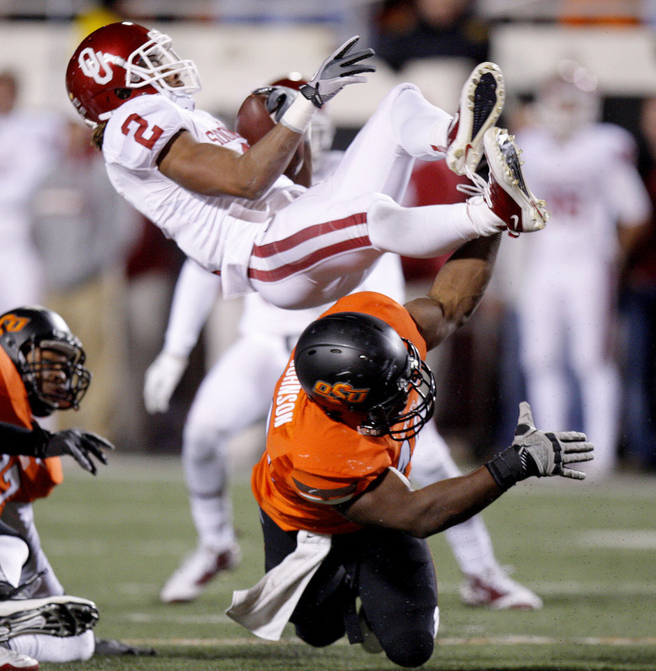 Photo - Oklahoma State's Tyler Johnson (40) brings down Oklahoma's Trey Franks (2)during the Bedlam college football game between the Oklahoma State University Cowboys (OSU) and the University of Oklahoma Sooners (OU) at Boone Pickens Stadium in Stillwater, Okla., Saturday, Dec. 3, 2011. Photo by Bryan Terry, The Oklahoman