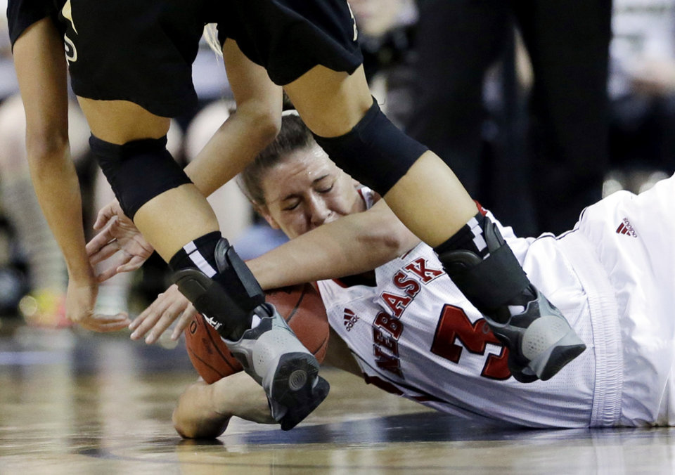 Photo - Nebraska forward Hailie Sample (3) battles for a loose ball against Purdue guard KK Houser (22) during the first half of an NCAA college basketball game in the Big Ten Conference tournament in Hoffman Estates, Ill., on Saturday, March 9, 2013. (AP Photo/Nam Y. Huh)