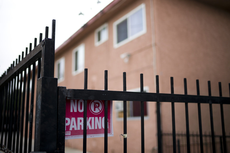 Photo - A no parking sign is posted on the fence outside an apartment building where kidnapping suspect Isidro Garcia lived on Thursday, May 22, 2014, in Bell Gardens, Calif. A woman who disappeared a decade ago as a 15-year-old reunited recently with her mother, who convinced her to go to authorities to report that she had been kidnapped and raped by a man who is now her husband and father of her daughter. (AP Photo/Jae C. Hong)