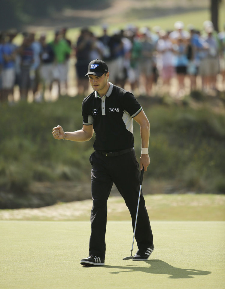 Photo - Martin Kaymer, of Germany, reacts to his birdie on the 16th hole during the second round of the U.S. Open golf tournament in Pinehurst, N.C., Friday, June 13, 2014. (AP Photo/Chuck Burton)