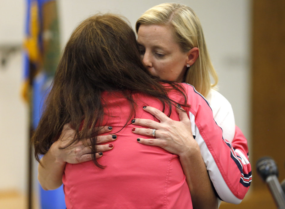 Briarwood Principal Shelly Jaques, left, hugs Plaza Towers Elementary Principal Amy Simpson in Moore, Okla., Friday, May, 24, 2013. Photo by Sarah Phipps, The Oklahoman