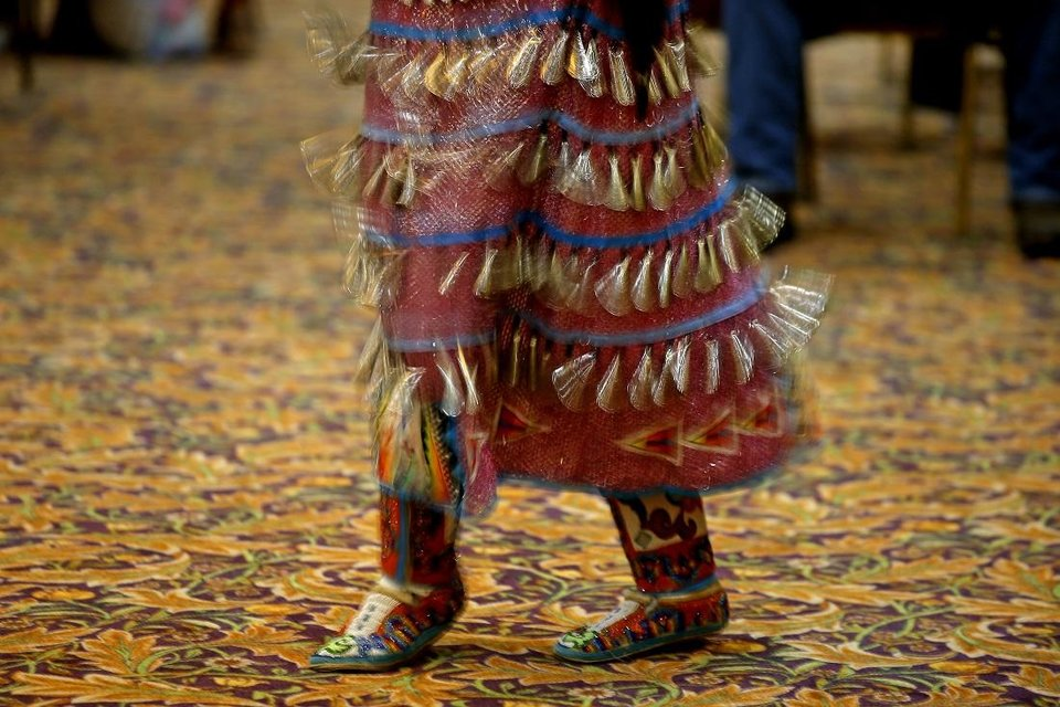 Photo - Sophia Thurman, who is Navaho, performs a women's jingle dance dance during a dance exhibition by the Central Plains Dancers at the Red Earth Festival at Grand Event Center at the Grand Casino Hotel & Resort, Saturday, Sept. 5, 2020. [Bryan Terry/The Oklahoman]