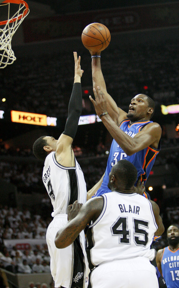 Photo - Oklahoma City's Kevin Durant (35) goes to the basket past San Antonio's Danny Green (4) and DeJuan Blair (45) during Game 5 of the Western Conference Finals between the Oklahoma City Thunder and the San Antonio Spurs in the NBA basketball playoffs at the AT&T Center in San Antonio, Monday, June 4, 2012. Photo by Nate Billings, The Oklahoman