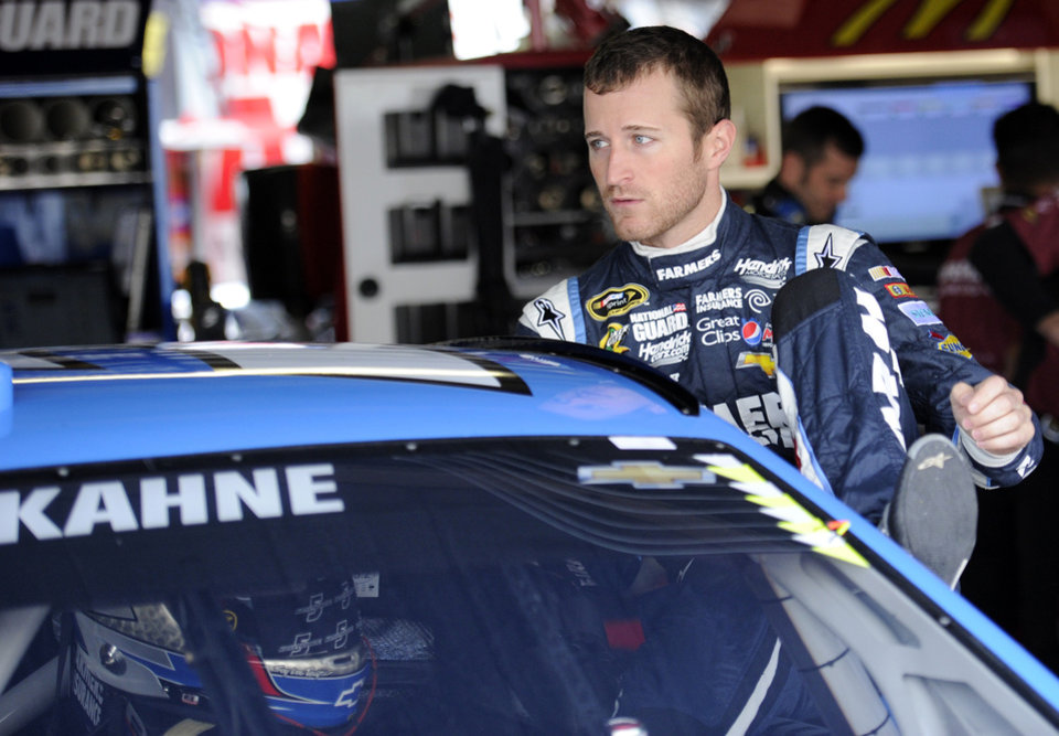 Photo - Kasey Kahne climbs into his car before practice for Sunday's NASCAR Sprint Cup series auto race, Saturday, Sept. 28, 2013, at Dover International Speedway in Dover, Del. (AP Photo/Nick Wass)