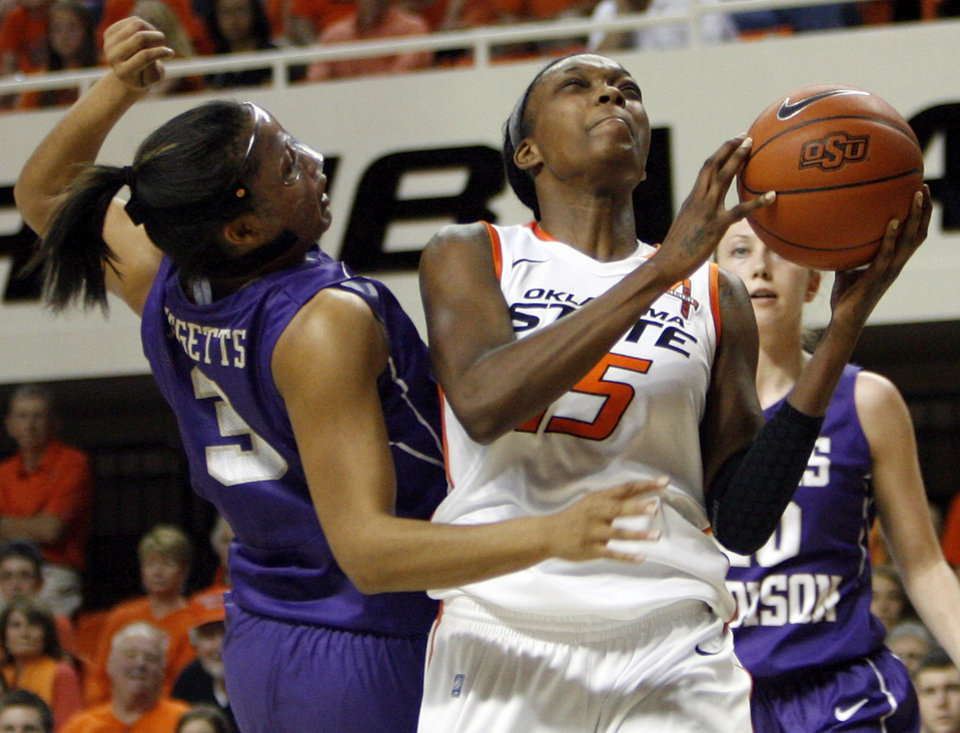 OSU's Toni Young (15) tries to get the ball past James Madison's Toia Giggetts (3) during the Women's NIT championship college basketball game between Oklahoma State University and James Madison at Gallagher-Iba Arena in Stillwater, Okla., Saturday, March 31, 2012. OSU won, 75-68. Photo by Nate Billings, The Oklahoman
