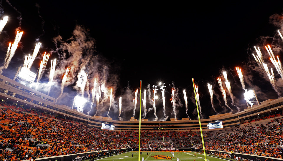Photo - Firework explode over Boone Pickens Stadium during the college football game between the Oklahoma State University Cowboys (OSU) the University of Texas Longhorns (UT) in Stillwater, Okla. on Saturday, Nov. 15, 2014.  Photo by Sarah Phipps, The Oklahoman
