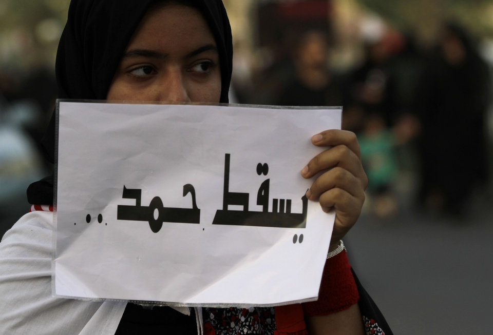 Photo -   A pro-democracy protester holds a sign reading