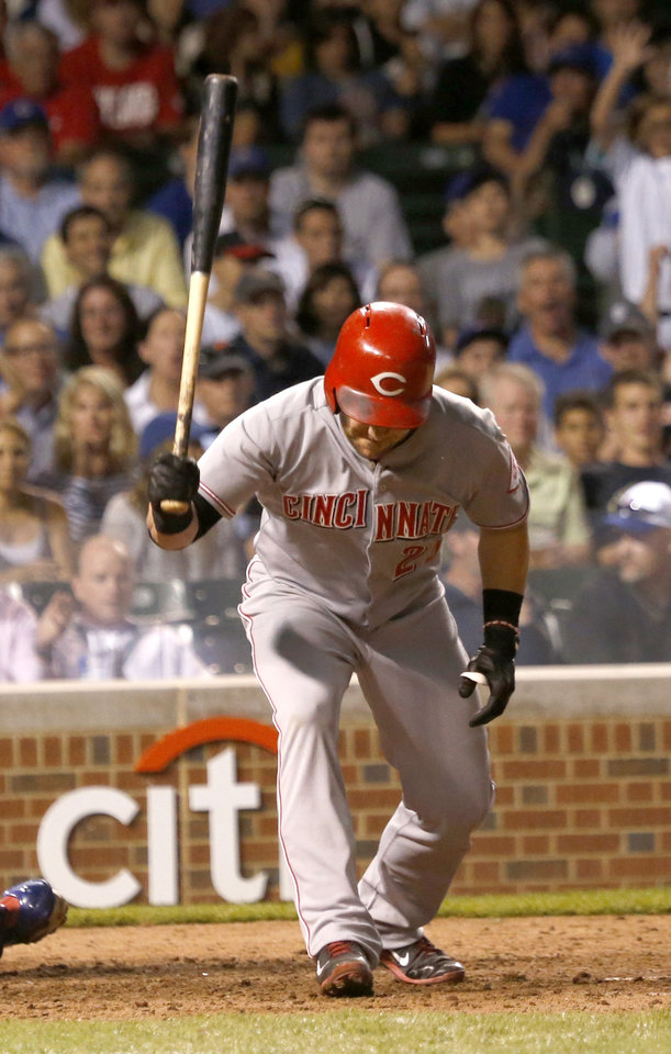 Photo - Cincinnati Reds' Skip Schumaker slams his bat to the ground after striking out on a pitch from Chicago Cubs starting pitcher Jeff Samardzija, to end the Reds' sixth inning of a baseball game Monday, June 23, 2014, in Chicago. (AP Photo/Charles Rex Arbogast)