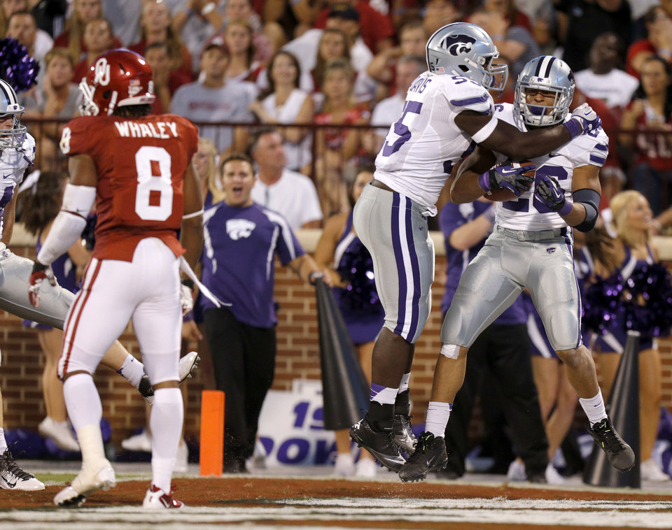 Photo - Kansas State's Jarell Childs (26) and Adam Davis (55) celebrate after a fumble recovery for a touchdown during a college football game between the University of Oklahoma Sooners (OU) and the Kansas State University Wildcats (KSU) at Gaylord Family-Oklahoma Memorial Stadium, Saturday, September 22, 2012. Photo by Bryan Terry, The Oklahoman