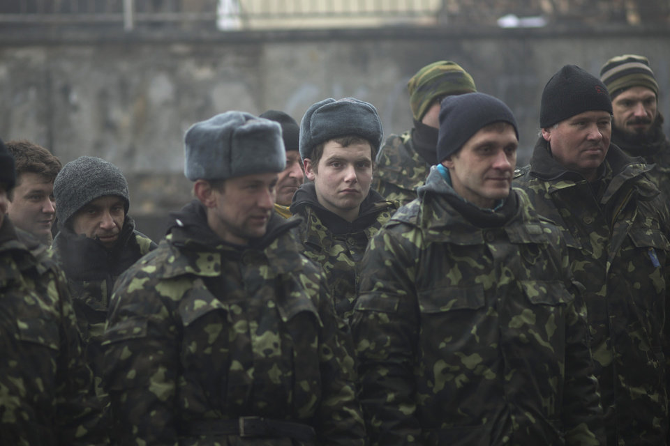 Photo - Ukrainian recruits receive military instructions from a commander at a recruitment center at Kiev's Independence Square, Ukraine, Tuesday, March 4, 2014. Vladimir Putin ordered tens of thousands of Russian troops participating in military exercises near Ukraine's border to return to their bases as U.S. Secretary of State John Kerry was on his way to Kiev. Tensions remained high in the strategic Ukrainian peninsula of Crimea with troops loyal to Moscow fired warning shots to ward off protesting Ukrainian soldiers. (AP Photo/Emilio Morenatti)
