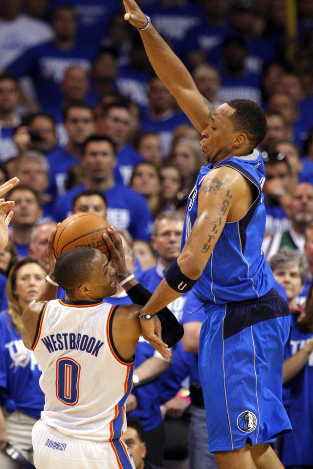 Oklahoma City's Russell Westbrook (0) shoots over as Shawn Marion (0) of Dallas defends during game 3 of the Western Conference Finals of the NBA basketball playoffs between the Dallas Mavericks and the Oklahoma City Thunder at the OKC Arena in downtown Oklahoma City, Saturday, May 21, 2011. Photo by Sarah Phipps, The Oklahoman