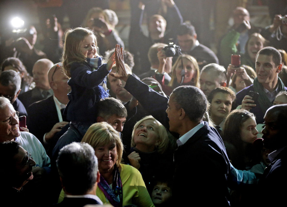Photo -   President Barack Obama high-five a young girls while meeting with supporters after speaking at a campaign event at Franklin County Fairgrounds in Hilliard, Ohio, Friday, Nov. 2, 2012. (AP Photo/Pablo Martinez Monsivais)