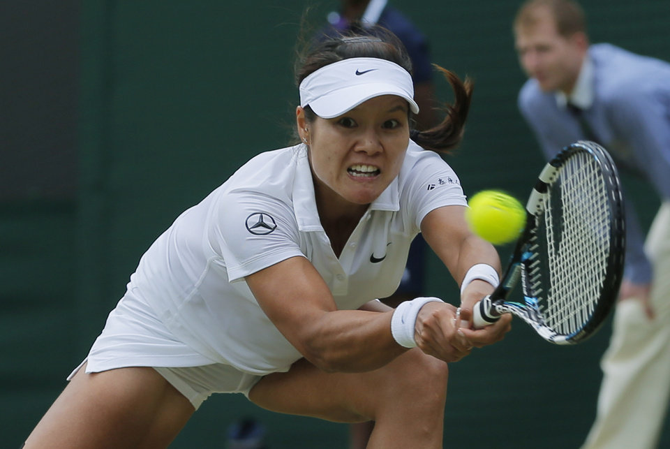 Photo - Li Na of China plays a return to Barbora Zahlavova Strycova of the Czech Republic during their women's singles match at the All England Lawn Tennis Championships in Wimbledon, London, Friday  June  27, 2014. (AP Photo/Pavel Golovkin)