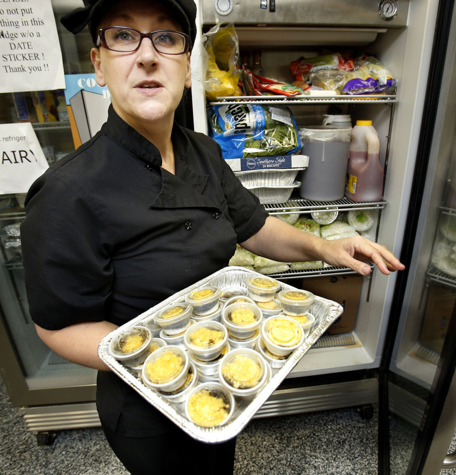 Amy Radford, director of food services at Food and Shelter Inc., shows pre-made seasoning packets for mashed potatoes that will be used to prepare Thanksgiving dinner in Norman for about 700 people.  Photo by Steve Sisney, The Oklahoman