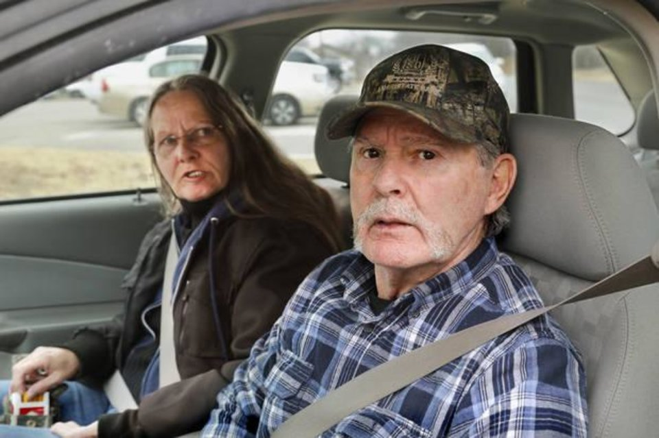 Photo -  Kenny Baker and his wife, Wyvondia, share their opinions about the sentencing agreement from inside their car after they finished business inside the Murray County Courthouse. [Photo by Jim Beckel, The Oklahoman]