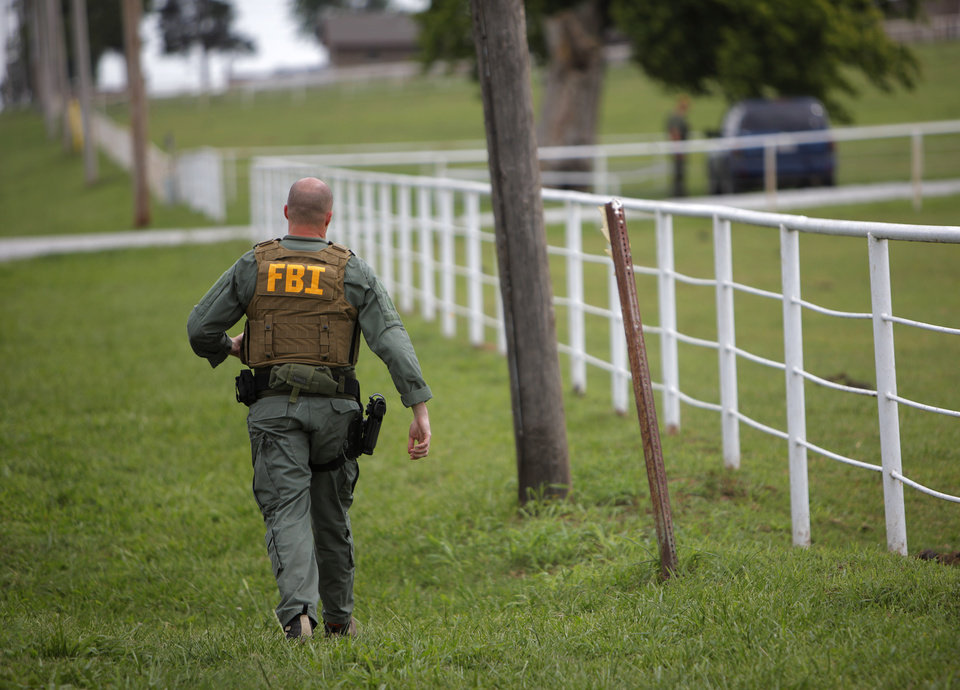 Federal agents converge at Zule Farms in Lexington, Tuesday, June 12, 2012.  The multi-state raid targeted the brother of a high-ranking official in a Mexican drug cartel for allegedly using a horse-breeding operation to launder money.   Photo by Garett Fisbeck, The Oklahoman