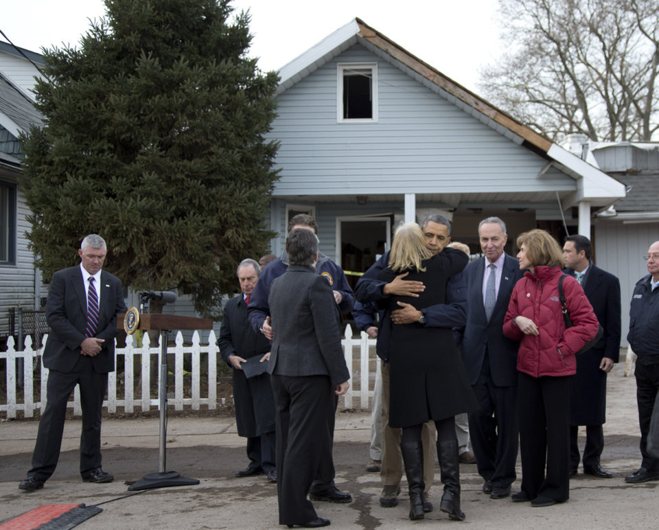 Photo -   President Barack Obama, accompanied by New York City Mayor Michael Bloomberg, New York Gov. Andrew Cuomo, Homeland Security Secretary Janet Napolitano, Sen. Charles Schumer, D.N.Y., and other, hugs Sen. Kirsten Gillibrand, D-N.Y., after a news conference on Cedar Grove Avenue, a street significantly impacted by Superstorm Sandy, Thursday, Nov. 15, 2012, on Staten Island, in New York. (AP Photo/Carolyn Kaster)