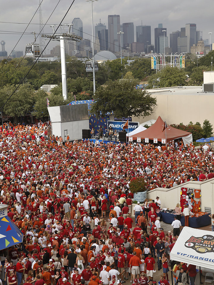 Photo - Sooner and Longhorn fans file into the Cotton Bowl stadium during the Red River Rivalry college football game between the University of Oklahoma Sooners (OU) and the University of Texas Longhorns (UT) at the Cotton Bowl in Dallas, Saturday, Oct. 8, 2011. Photo by Chris Landsberger, The Oklahoman
