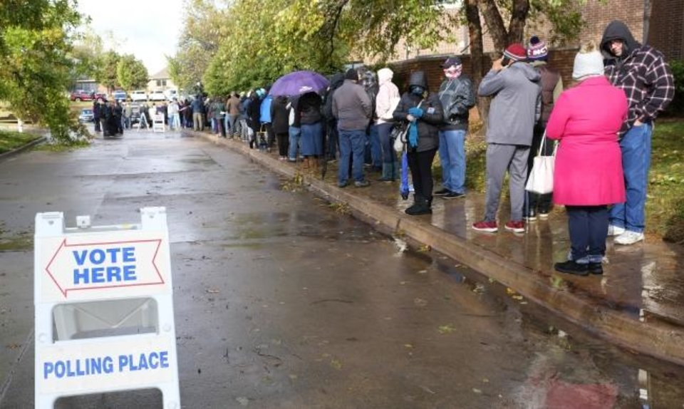 Photo -  Line of voters wraps around the church. Early voting for Oklahoma County at Church of Christ, 801 S Bryant Ave., Edmond,  Thursday, October 29, 2020. [Doug Hoke/The Oklahoman]