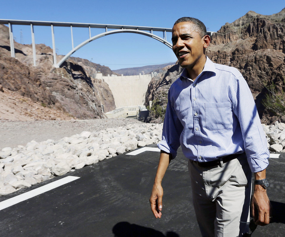Photo -   President Barack Obama stands at the heliport overlooking the Hoover Dam, Tuesday, Oct. 2, 2012 in Boulder City, Nev. (AP Photo/Pablo Martinez Monsivais)