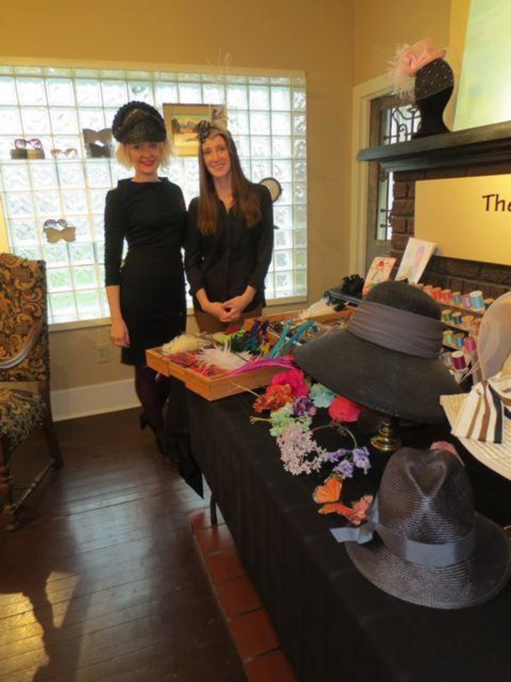 "Marla Deann Cook, Milliner, and Lydia Sullivan, Milliner, show hats at JRB Art at the Elms Art Gallery. They recently conducted a hat workshop. The Gallery is featuring Rosemary Burk's exhibit ""Fashion As A Wearable Art.""  Marla has a hat studio in one of the the Gallery's rooms. (Photo by Helen Ford Wallace)."