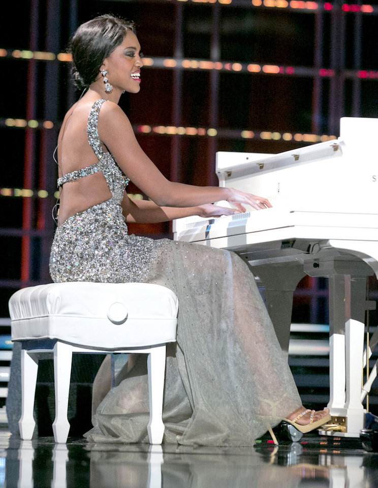 This photo courtesy Miss America Organization shows Miss North Dakota Rosie Sauvageau took top honors Thursday, Jan. 10, 2013, after her piano and vocal rendition of