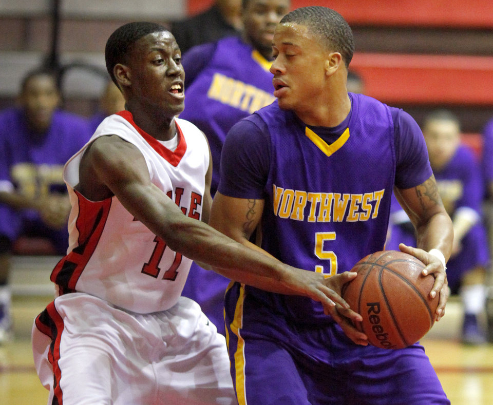 Northwest Classen's Terry Arnold gains control of the basketball beside Del City's Jamal Moseley during the boys Class 5A regional basketball game in Del City, Okla., Saturday, Feb. 25, 2012. Photo By Bryan Terry, The Oklahoman